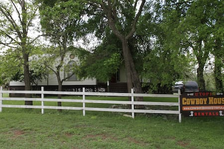 Our 2 houses sit on 3.8 acres along the Sabinal River, immediately across the river from Utopia Park.  We are 15 min. from Garner State Park and 15 min. from Lost Maple State Natural Area. People come for rodeos, birdwatching, hiking, & river fun.