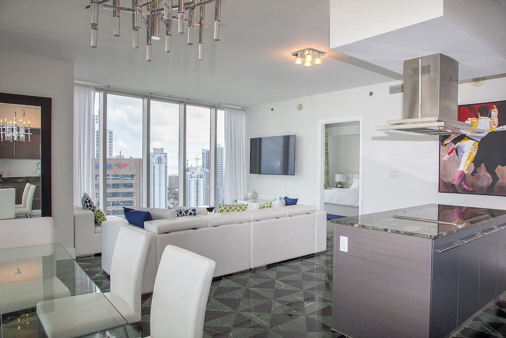 Large living room integrated with dining area and kitchen with amazing views from all over.