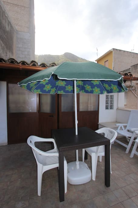Guests can enjoy this marvellous terrace equipped with a table and chairs for eating outside