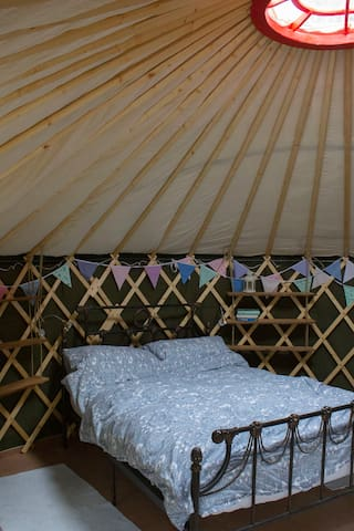 The comfy double bed is supplied with cotton sheets and warm bedding