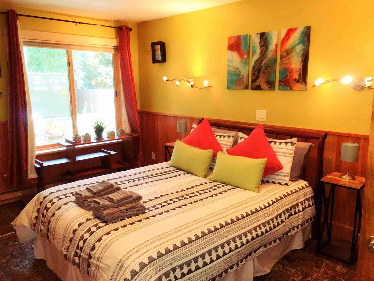 This is the spacious master bedroom, lots of light and a comfortable bed.