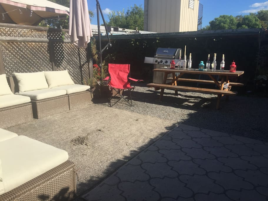 Sunny patio with sectional and BBQ