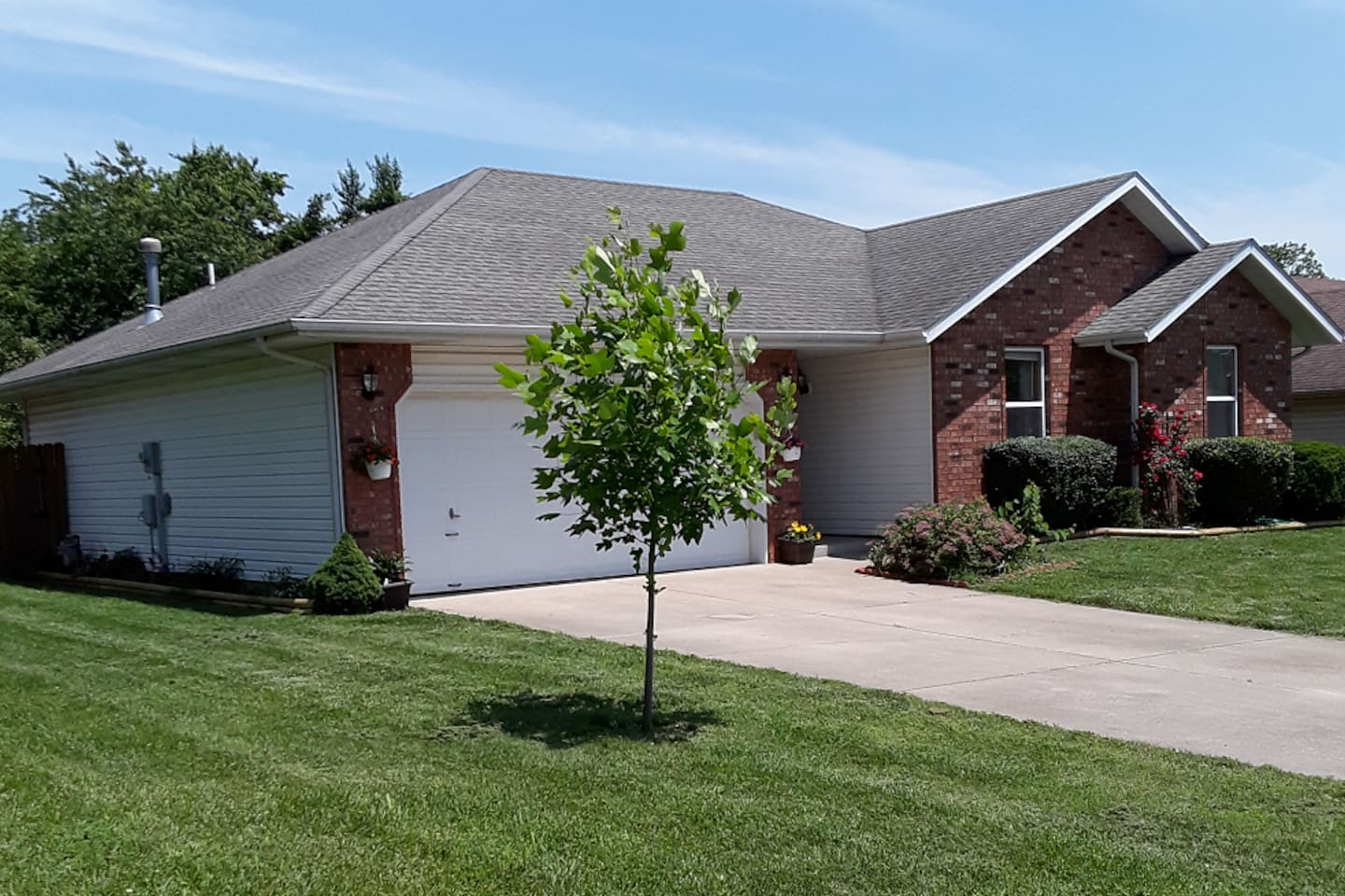 Well maintained yard, which includes the use of the garage, fenced back yard and deck