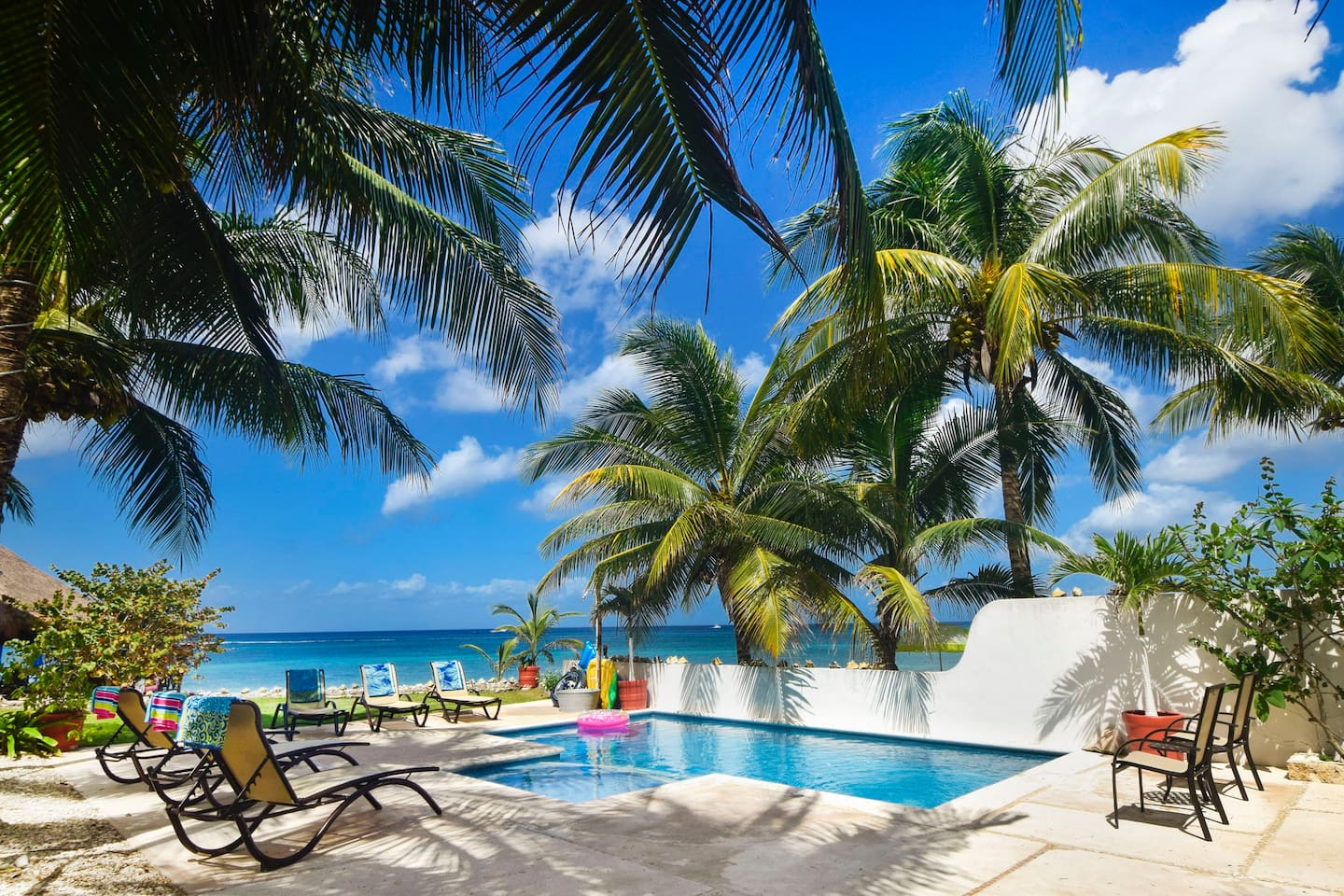 Your paradise awaits. Private pool only steps from your beach.