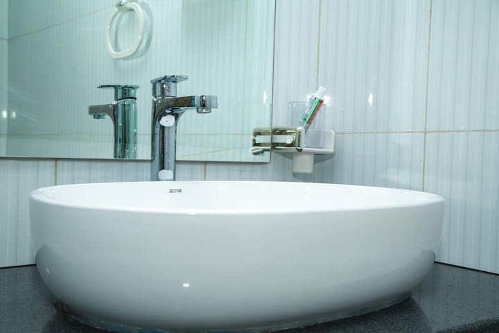 Sink in the bathroom with warm and cold water