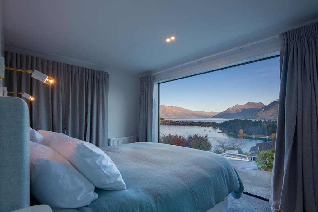 Master bedroom with views over Lake Wakitipu and the Remarkables