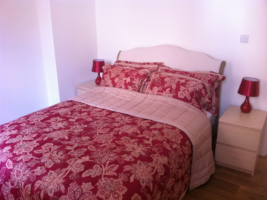 King-size bed in the Red Room. There is also plenty of wardrobe space.