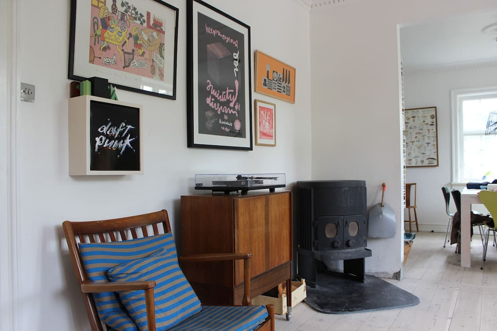 Living room with record player and fire place