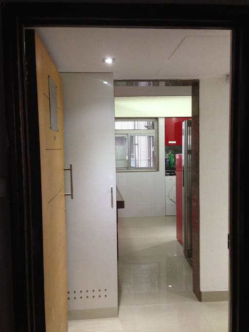 Entrance to the Apartment which opens up in the kitchen
