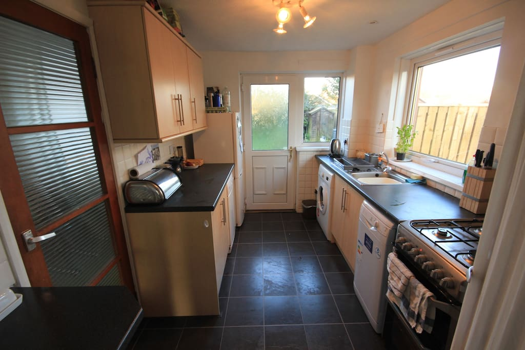 Well equiped kitchen with dishwasher, washing machine and tumble drier.