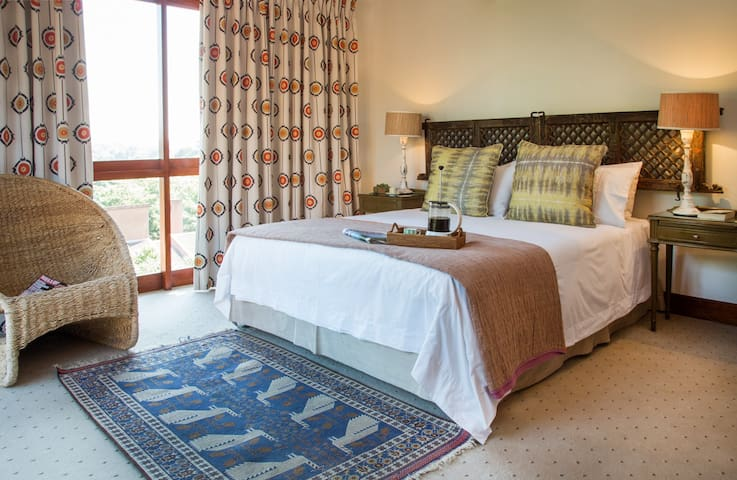 Second bedroom en-suite upstairs with a private balcony, golf course and vegetation views