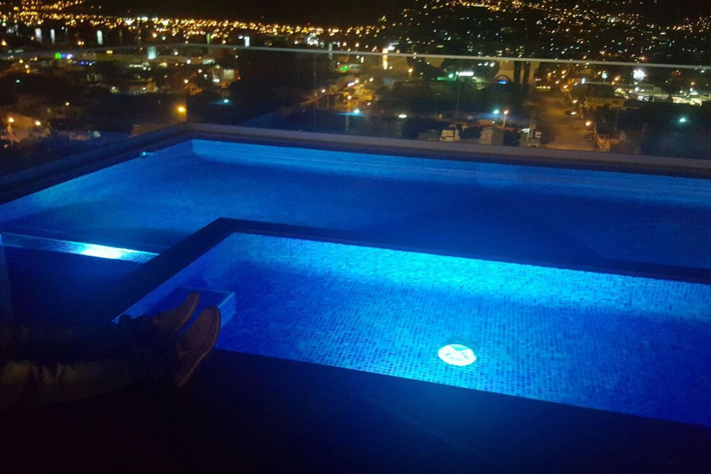 The top roof pool at night.