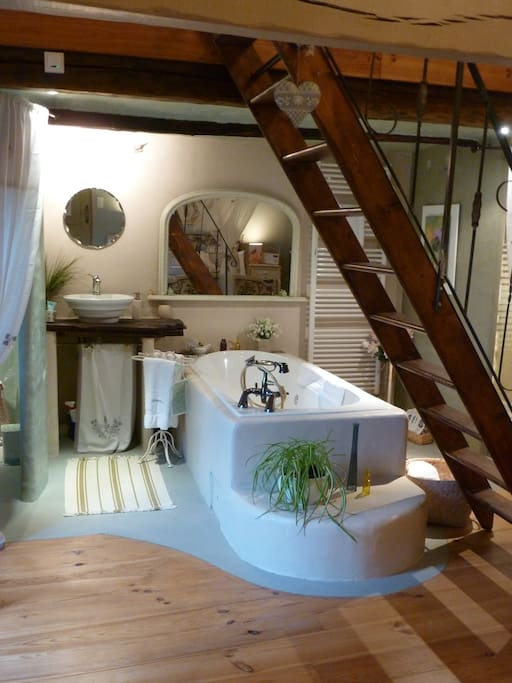 3rd Floor Superior room - L'Aveyron, Photo shows whirlpool bath. Room sleeps 3 (1 on sofa bed on mezzanine). Ideal romantic hideaway. Whirlpool bath, WC, shower and handbasin in room. Views over medieval roof tops. Quiet position on pedestrian road. Direc