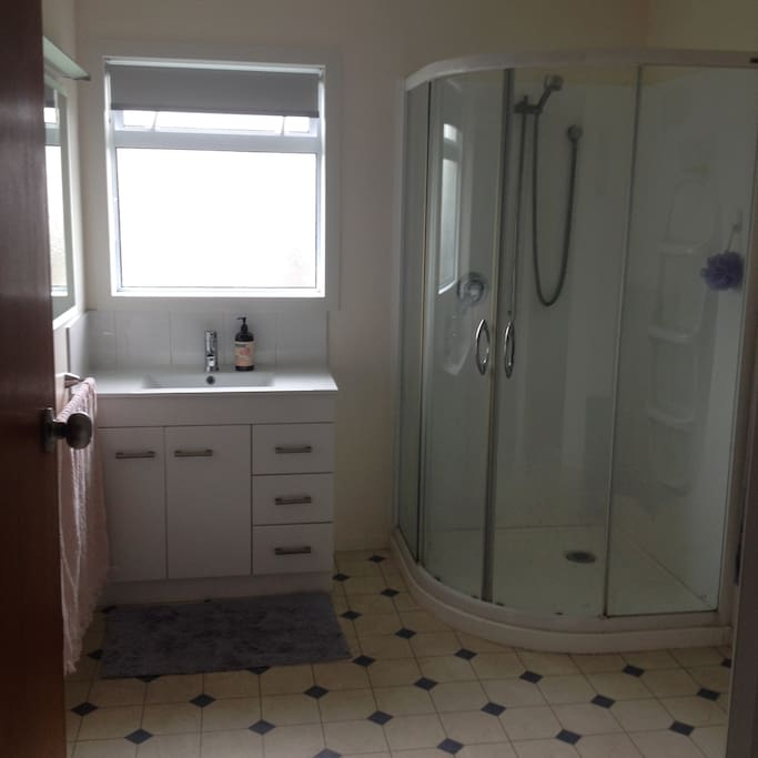 Bathroom has shower and basin with separate toilet room