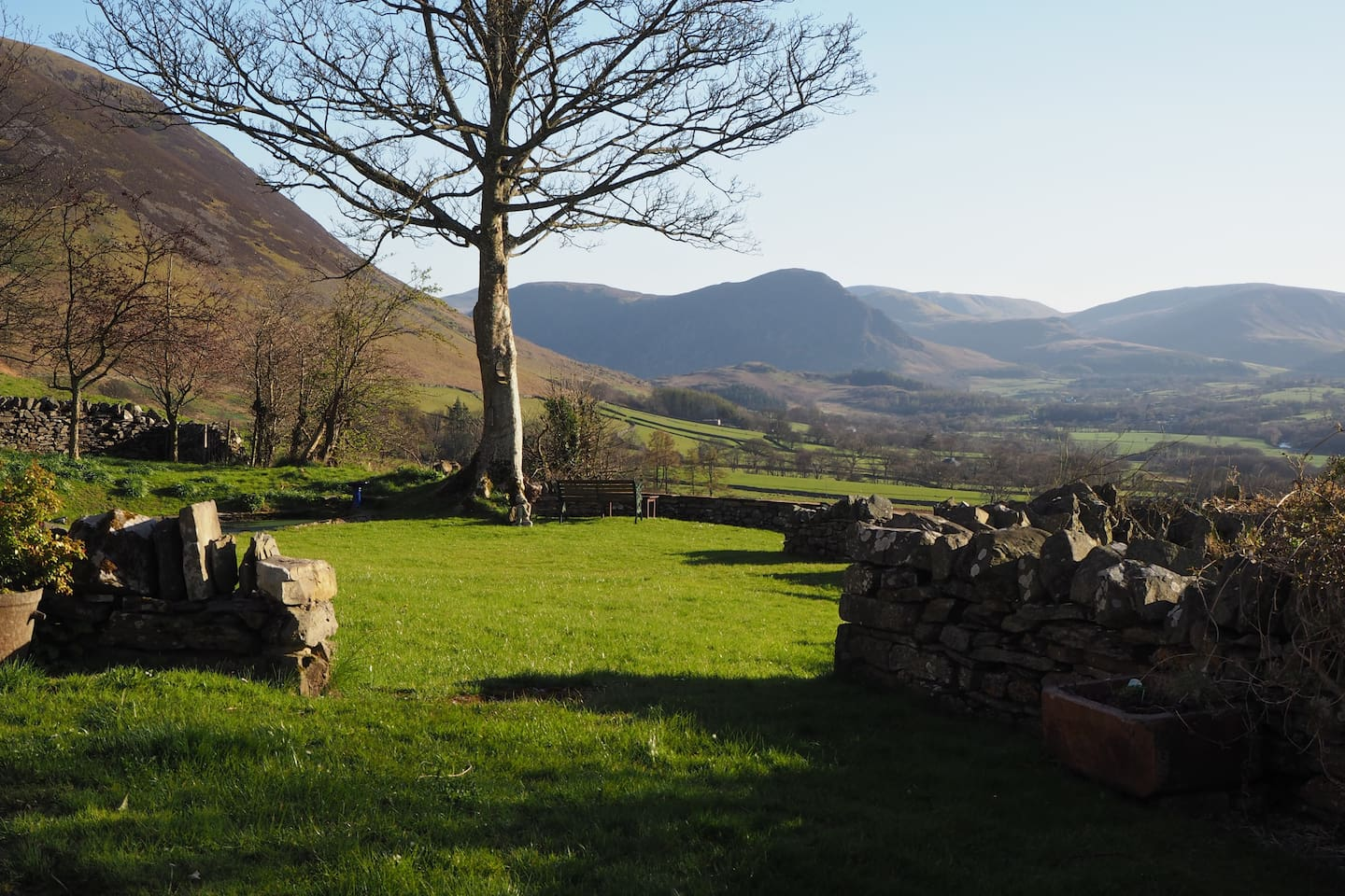 Part of the panoramic view from the High Swinside garden looking down the Lorton valley towards Melbreak and Crummock Water.