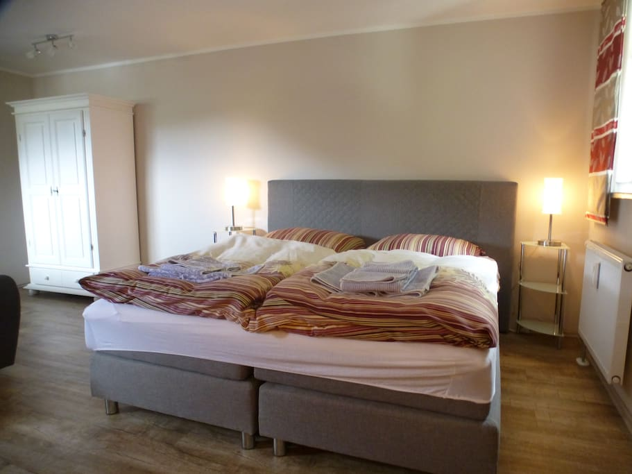 In the end of the room (40m2) the king-size bed 190x200 cm.