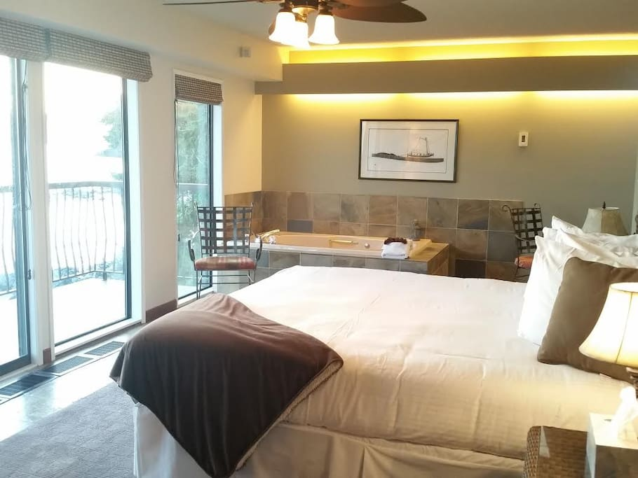 Spa Suite with balcony overlooking the ocean and jacuzzi tub right in the room.