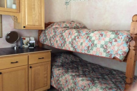 local taxes of  13% are due upon arrival.. Do not have to share room  This room is small but, has a private/attached bath, with shower. the room also doubles as a laundry room-- Must ask to use! AC and ceiling fan.   breakfast ($10-15  per person)