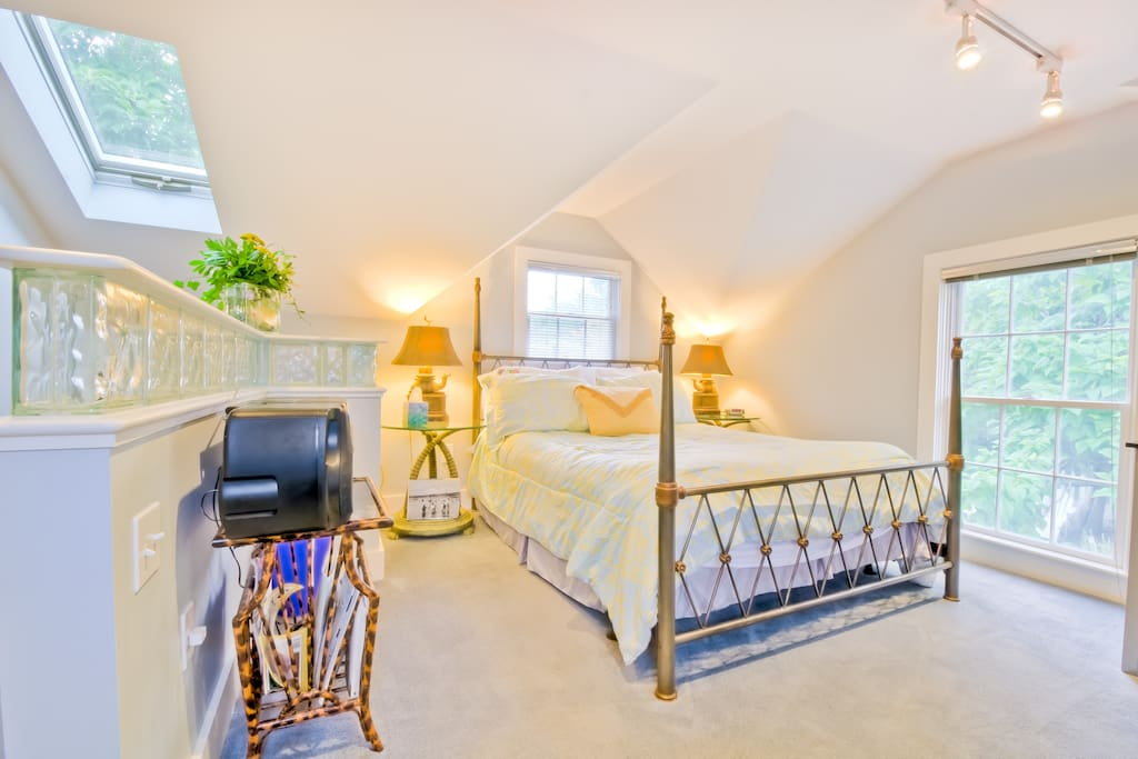 COZY Loft bedroom with QUEEN size BED and all linens provided.  There is a TV, CD player and radio.