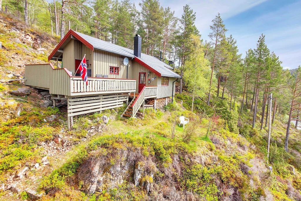 The cabin lies in a hill with ocean view.