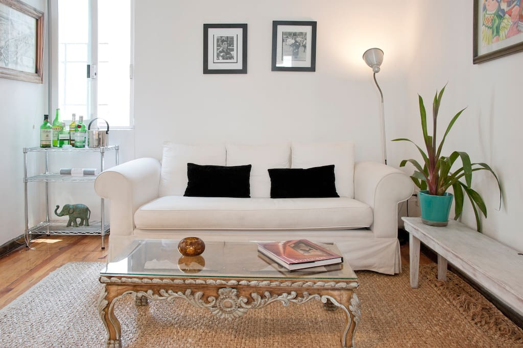 Very lighted living room space with comfortable couch.