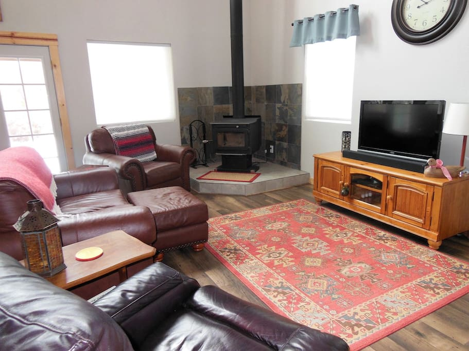 Large Screen TV and Wood Stove in Large Living Area