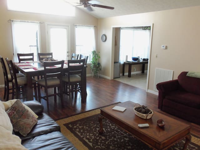Living room and dining room.  Table seats 8.  Pull out sofa-bed.