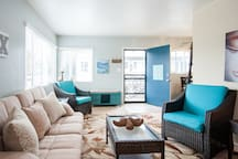 Comfortable beach living with fold out Queen size bed in Living Room.