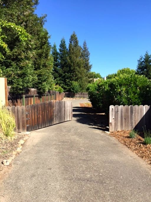 Enter the private, gated driveway. There's plenty of parking with room for up to 4 cars.