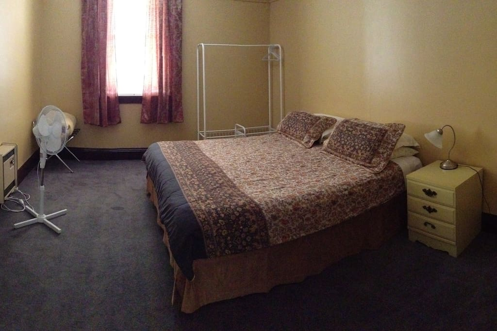 King bedroom with TV and electric blankets