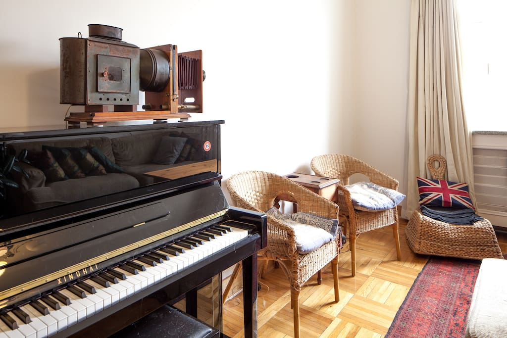 piano, old projector and the two chairs that belong to the cats.
