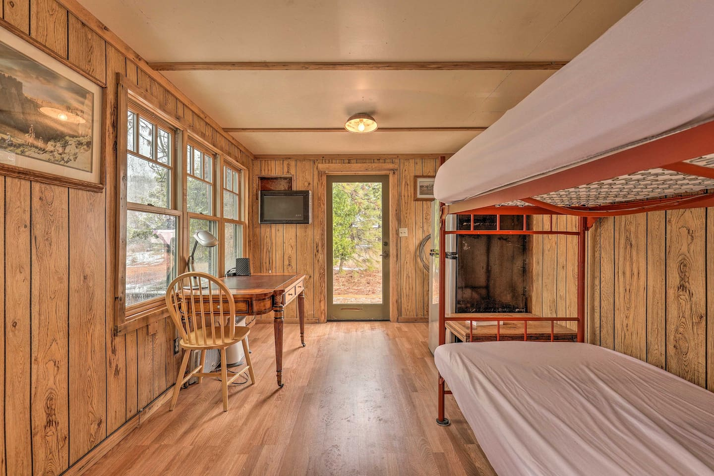 The bunkhouse features beds for 4 and a flat-screen Smart TV.