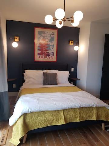Second bedroom with queen bed, patio, walk-in closet and TV.