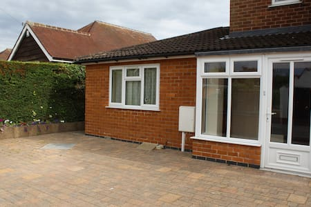 Self contained ground floor annexe in large house.