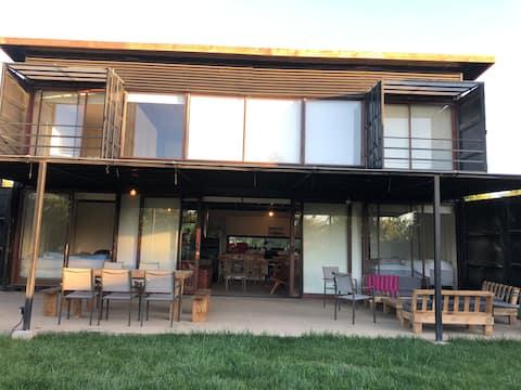 Casa en condominio frente lago Colbun