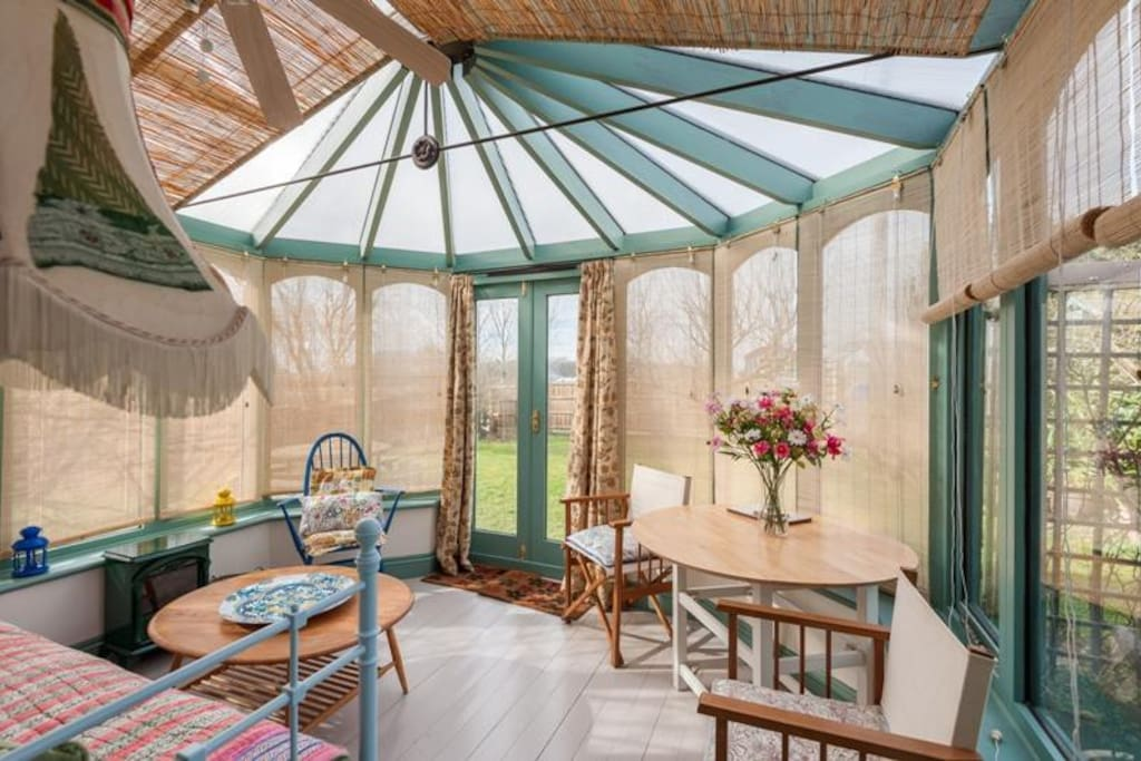 Light and airy conservatory - with a day bed.