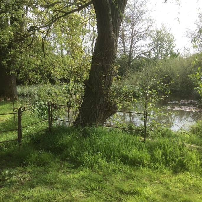 Set by a peaceful pond . Relax and wonder through pathways and wild flowers.
