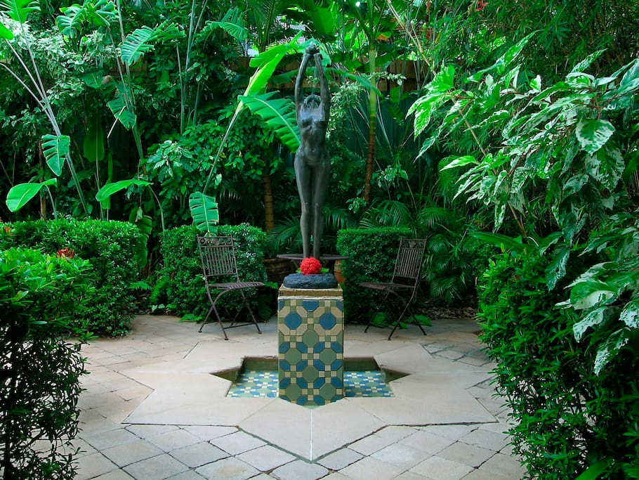 Tropical gardens surround the property