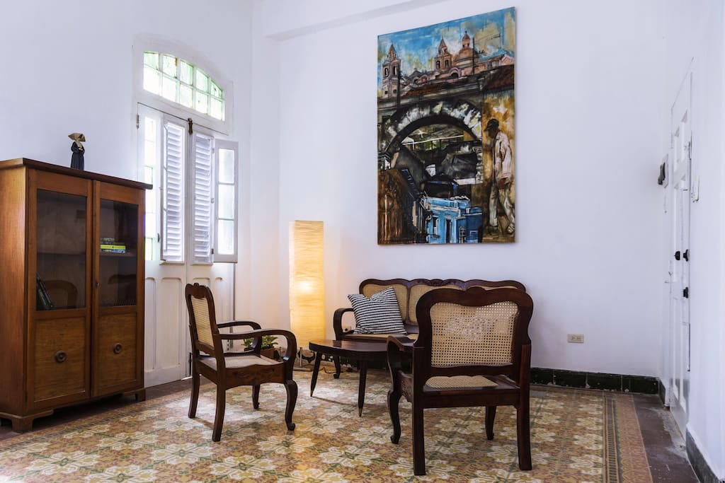 Living room with painting by Aylén Russinyol