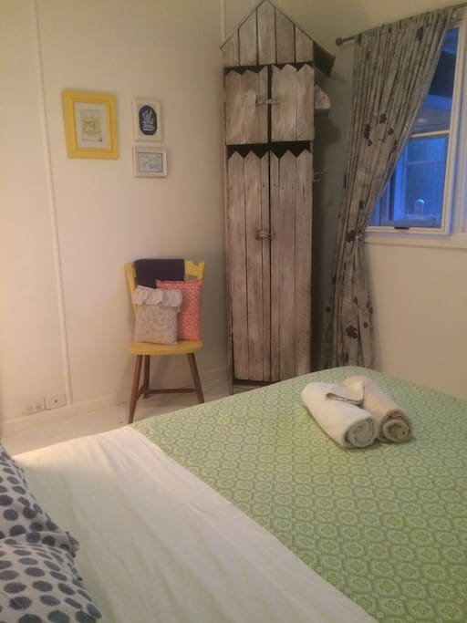 The main bedroom has a quirky beachy feel with the cute and cool wardrobe