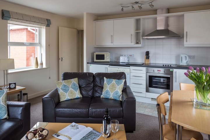 Open plan living, kitchen, and dining space in a 1 bed apartment