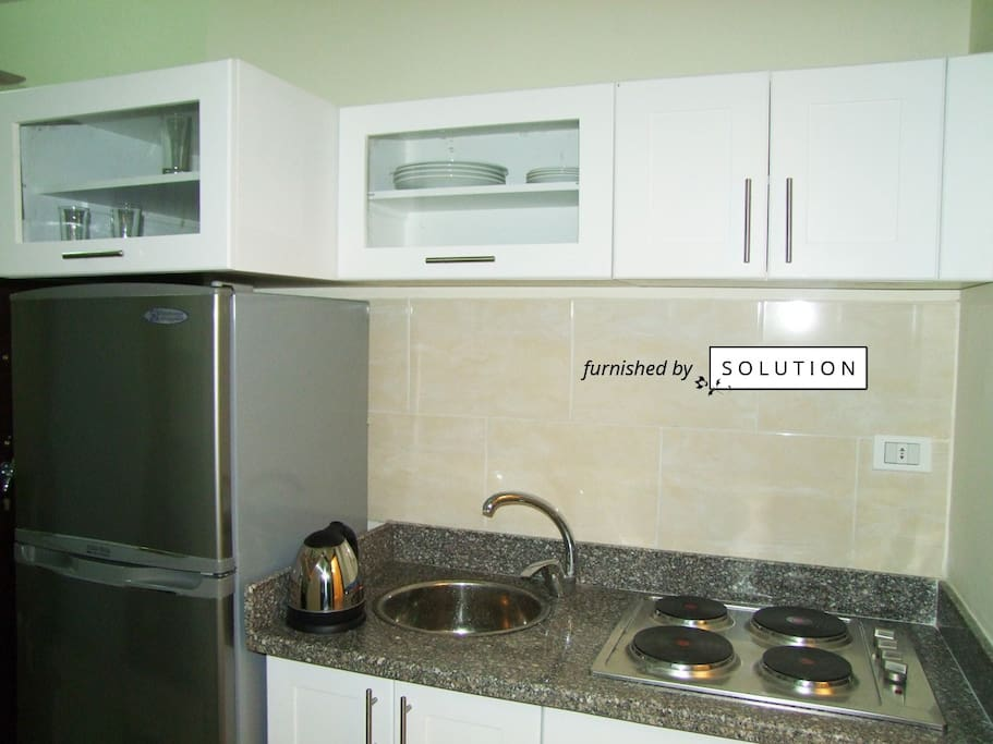 2-compartment refrigerator and 4-eye hob at the kitchen