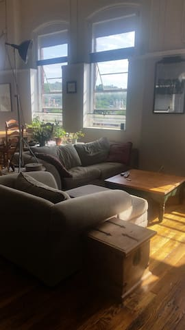 Comfortable couch and love seat, large screen television with cable