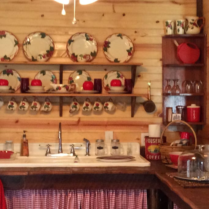 A bright full kitchen is ready for enjoying the antique and vintage features or for cooking and entertaining.