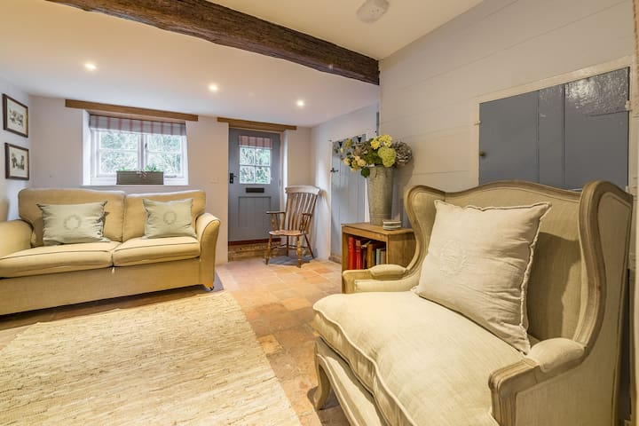 Ground floor:  Sitting room with comfy sofas