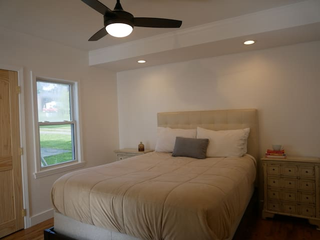 Bedroom number one, with a plush queen, was also very recently remodeled and has brand new hardwood floors.  This room also has a full desk, not pictured, if you need to get work done.  We will have curtains up by the time you arrive!