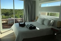 large sliding glass doors to take advantage of the breeze.  Bedroom also airconditioned