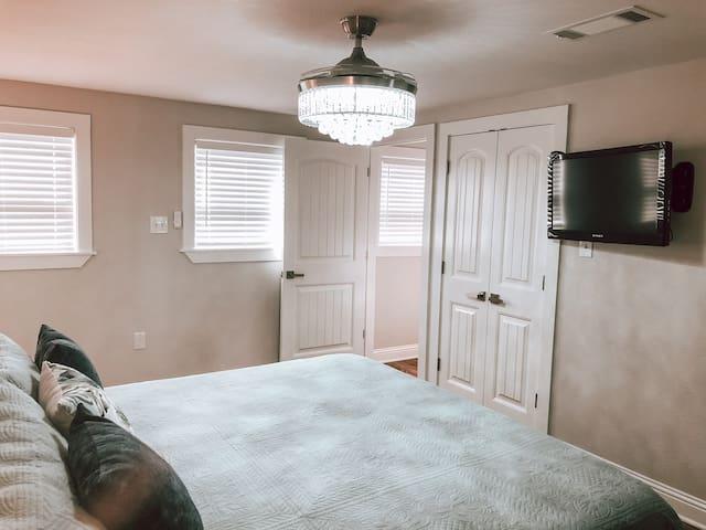 Bedroom with chandelier fan
