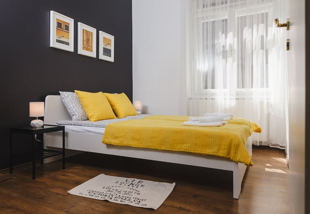 Yellow bedroom with a double bed