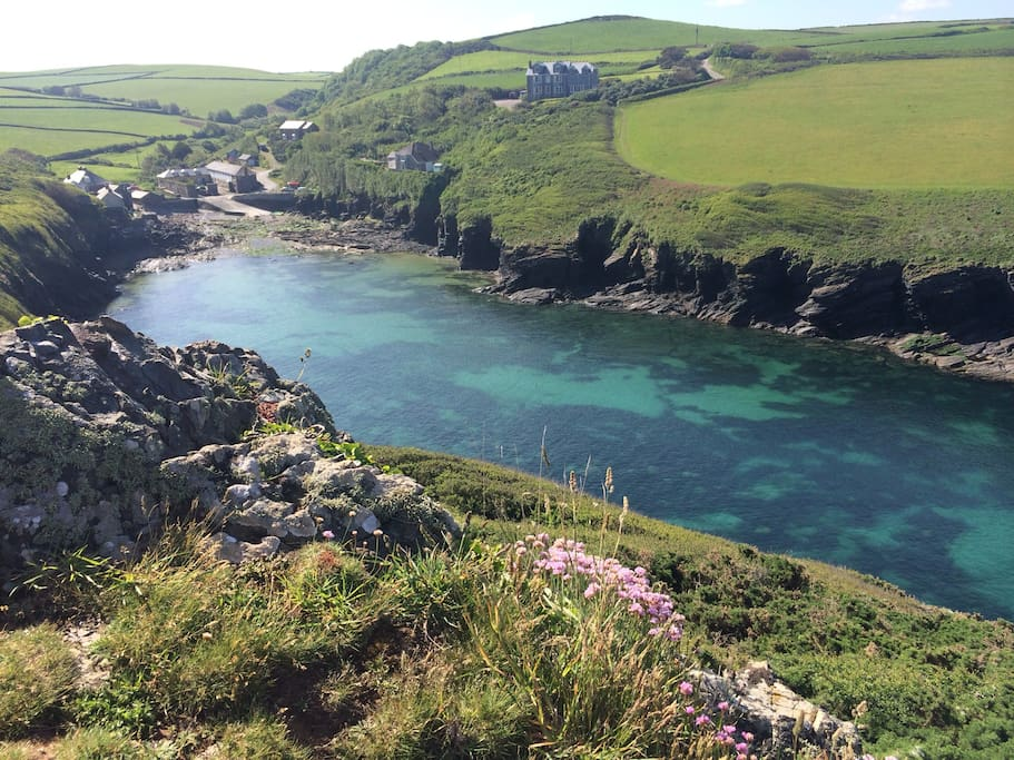 Port Quin is spectacular and a great place to explore either at high or low tide. Image shows the crystal clear water that makes it such a good swimming spot.